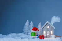 Christmas card with house and gifts