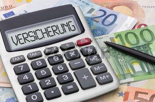 Calculator with money - Insurance - Versicherung (German)