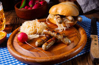 rustic  Nürnberger bratwurst with sauerkraut and roll