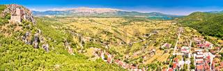 Town of Vrlika and Peruca lake aerial panoramic view