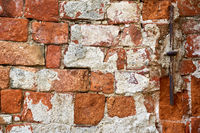 old repaired wall with brick texture
