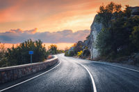 Beautiful asphalt road in mountains in the evening