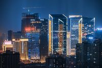 Fraser Suites and Wanda buildings illuminated at night aerial view in Chengdu