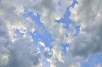 Blue sky background with cumulus clouds at sunlight backlit