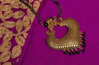 Artificial golden temple necklace.
