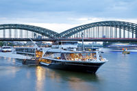 ships on Rhine river and Hohenzollern Bridge in the evening, Cologne, Germany, Europe