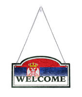 Serbia welcomes you! Old metal sign isolated