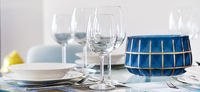 Table appointment setting at restaurant fragile wine or water glasses and plates