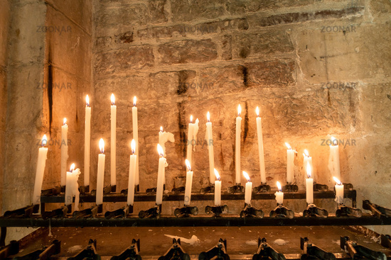 candles in a church in Italy