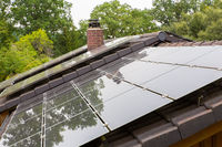 Roof surface of house with black solar panels
