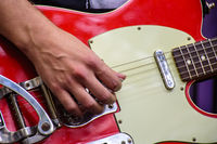 Hand detail playing eletric guitar