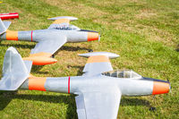 Model planes on a green field in the summer