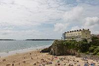 People on beach in Tenby, Wales, UK