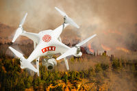 Fire Department Unmanned Aircraft System, (UAS) Drone Isolated Above a Forest Fire
