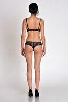 Back woman  full lenght figure in underwear