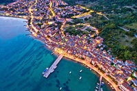 Baska. Aerial evening view of town of Baska coast and harbor.