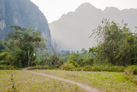 Path towards the mountains of Vang Vieng