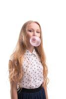 Pretty teenaged girl with bubble gum portrait