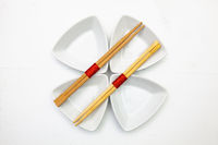 Ceramic bowls  and bamboo chopsticks for sushi food .
