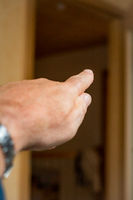 Man's hand with outstretched index finger