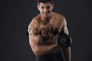 Muscular man lifting weights