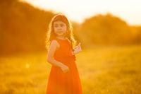 Beautiful 5 years girl in evening Sun Light.