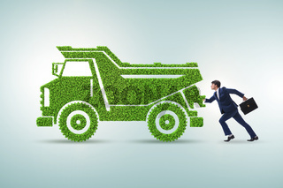 Businessman with green ecological vehicle