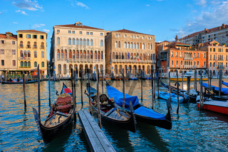 Grand Canal with boats and gondolas on sunset, Venice, Italy