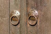 Old door lock. Old locked padlock with rings on old wooden board door.Old metal padlock on a wooden