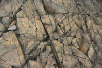 Natural stone background with cracks. Close up view.