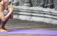 Woman doing yoga in abandoned temple. Outdoore