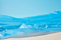 Blue plastic garbage bag as a seascape background.