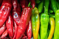 Bunch of green and red hot chillies