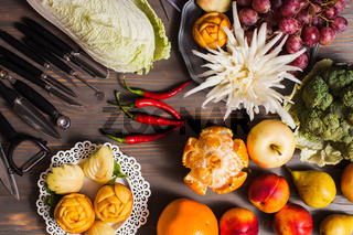 Chinese fruit carving, flat lay props on the table