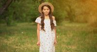 The Beautiful Girl In A Straw Hat In The Garden
