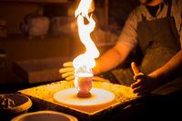 Burning ceramic mug on pottery wheel