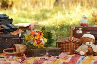 Romantic autumn still life with books