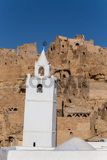White wahsed mosque in a traditional village in Tunisia