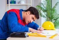 Foreman looking at construction plan