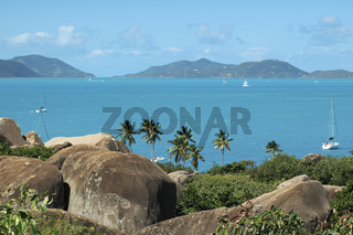 Scenic View With Large Granite Stones, Palm Trees And Turquoise Blue Water, Tortola, Caribbean Islands