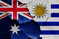 flags of Australia and Uruguay painted on cracked wall