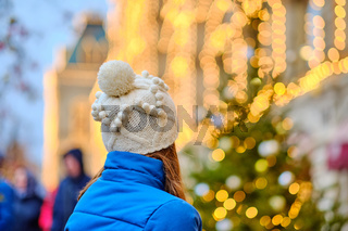 Woman looking at Christmas tree