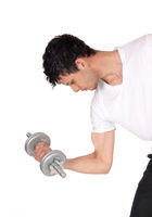 Young man exercising with his dumbbells, in close up