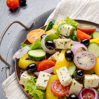Top view at Mediterranean diet dish greek salad on vintage metal tray