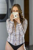 Lovely Brunette Model Taking Photos At Home