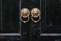 Lion chinese door knockers on a black door