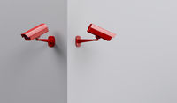 Two red security cameras