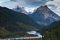 A mountain and river in the Canadian Rockies at sunset
