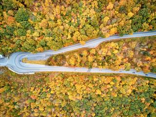 Scenic highway hairpin turn in autumn