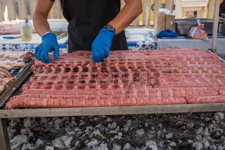 Man cooking sausage on grill